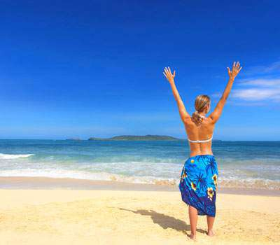 Default Carousel Woman Sarong Hands Up Beach